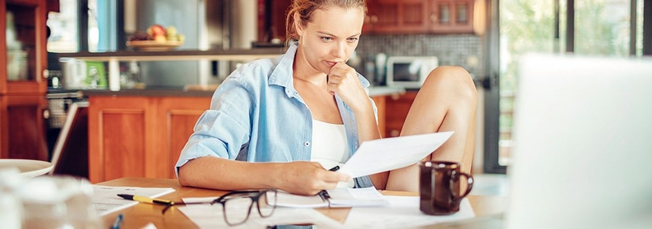 Young woman looking at her longstanding debt considering the best way to consolidate it