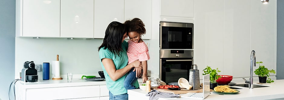 Mother and daughter spending time in their brand new renovated kitchen