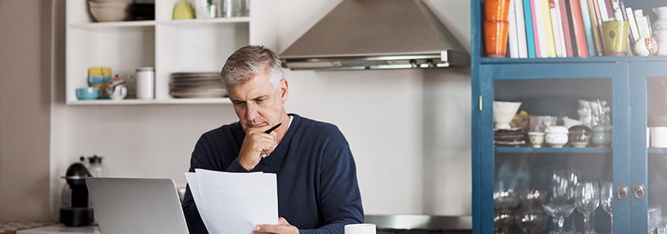 Man looking at his credit score taking steps towards getting his finances in order