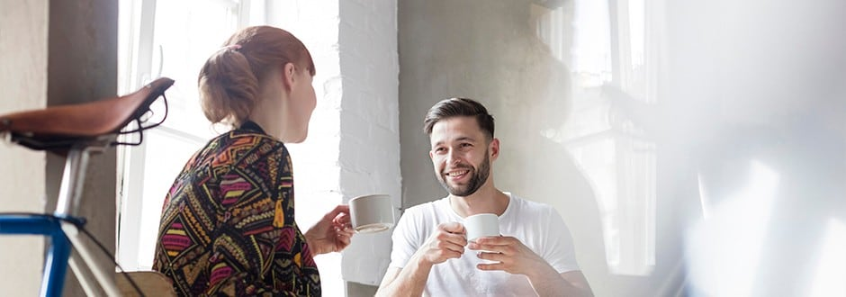 Couple drinking coffee as they compare home equity line of credit rates in Florida