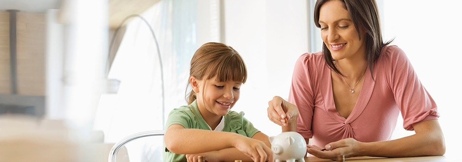 Mother teaching her daughter about saving up and eliminating debt