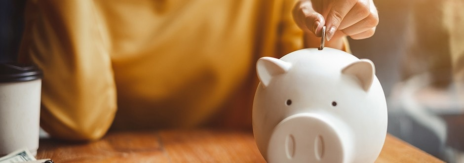 Saving money in a piggy bank for an emergency fund that can help pay for an unexpected major expense.