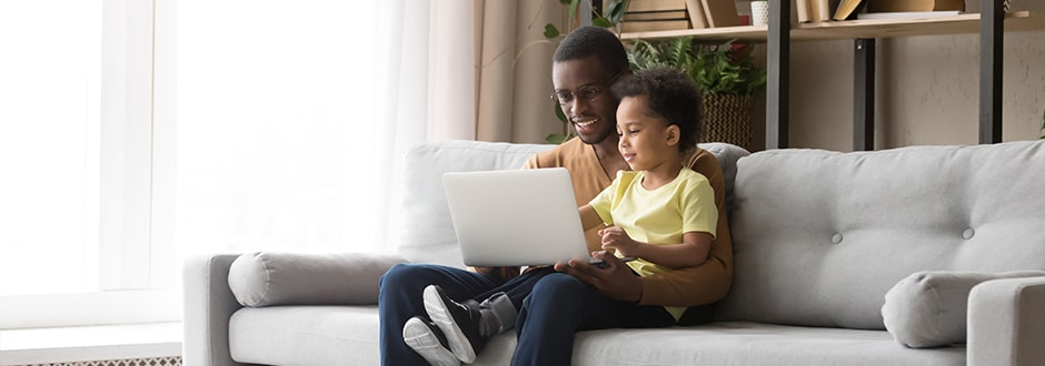 Young father with his son, calculating the costs and benefits of refinancing his home