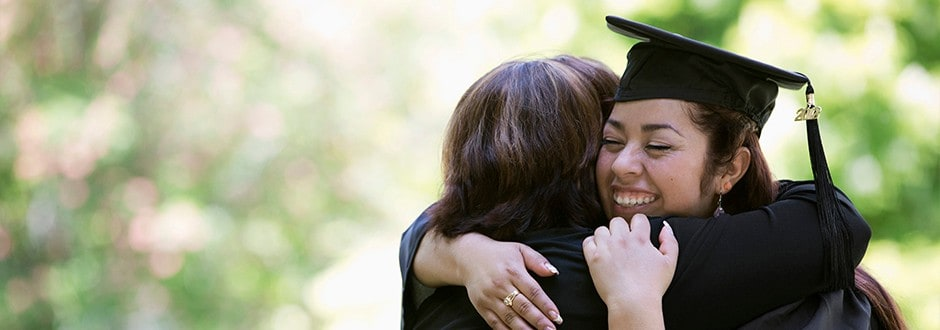 Woman embracing her mother who helped finance her education with a home equity loan