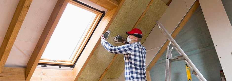 Man installs insulation in his attic renovation as a way to increase his home value with the equity that he has already built