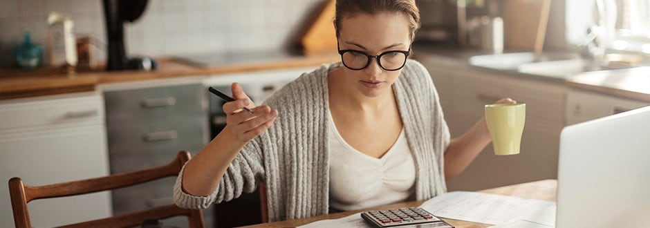 Woman drinks coffee while evaluating the different home equity lenders that she can choose based on their pros and cons