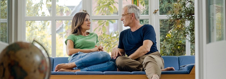 Couple discussing the best home equity loans, what options are available, and what works best for them