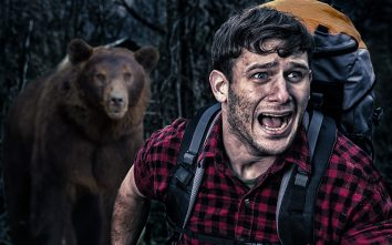 Man in woods being chased by bear - side hustle