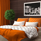 eclectic orange bedspread and bedroom