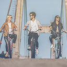 three people on bikes