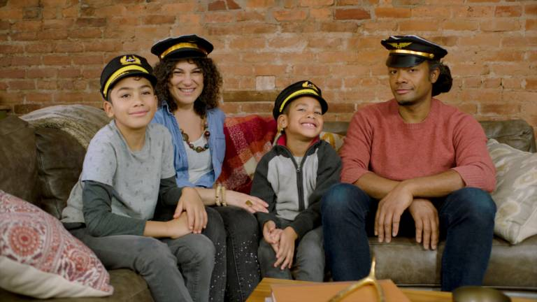 family wearing pilot hats