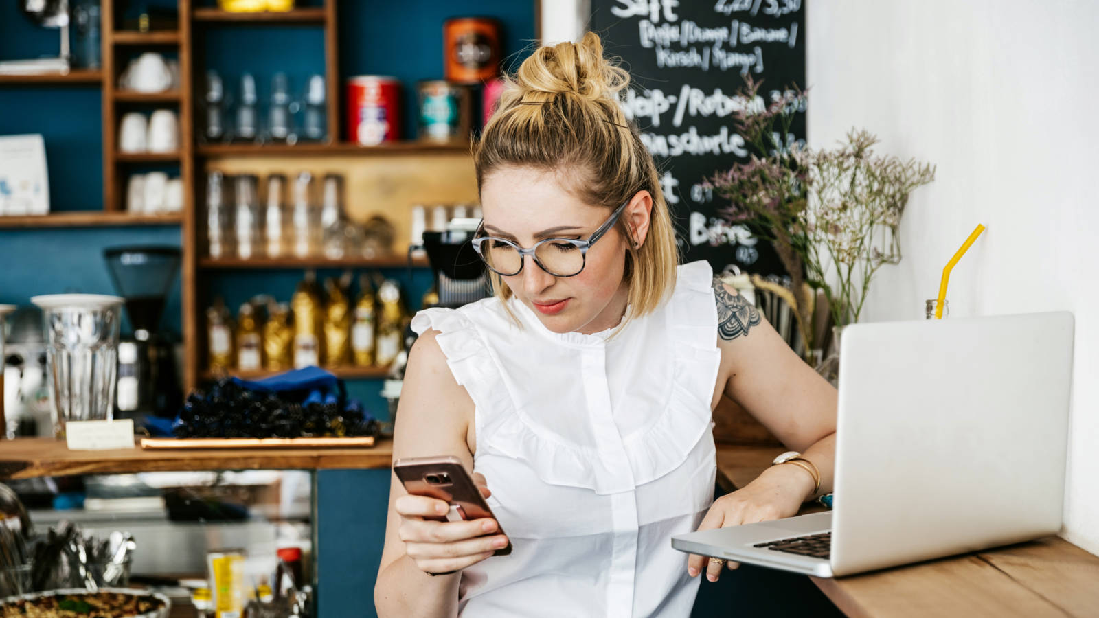 Woman checking details of her credit card interest rate on her phone