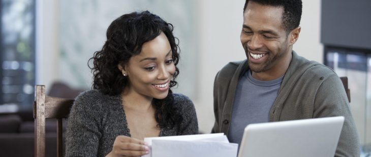 Young couple using the envelope system to track their finances