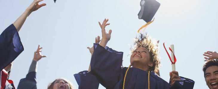 New graduates throwing their caps in the air at graduation
