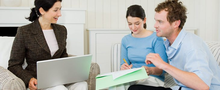 Couple meets with a financial advisor to discuss how interest rates impact their financial plan
