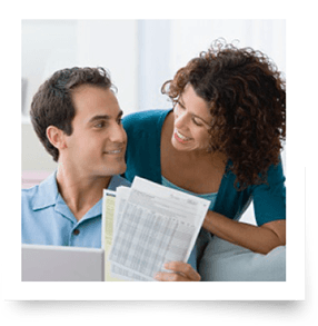 Couple Reviewing Options For Debt Consolidation